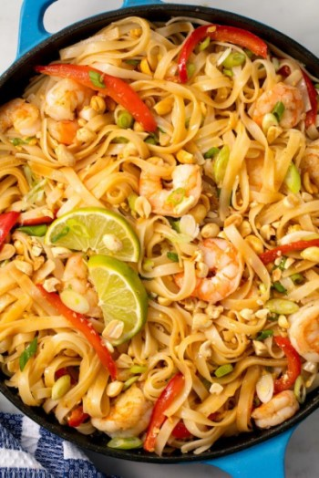 Shrimp Pad Thai in Pan with Limes on Top