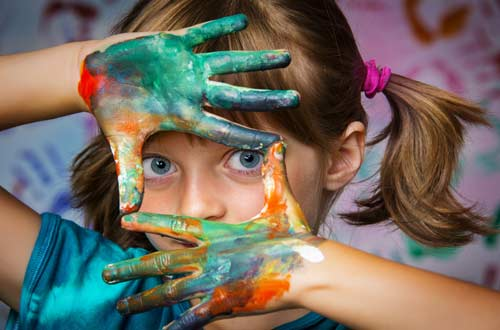 Child with paint on hands.